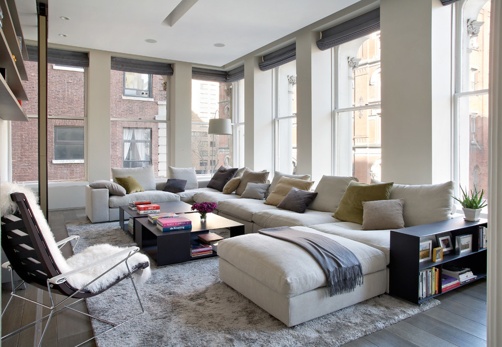 nice looking family room with apartment sectional sofas in white plus black  wooden coffee table plus