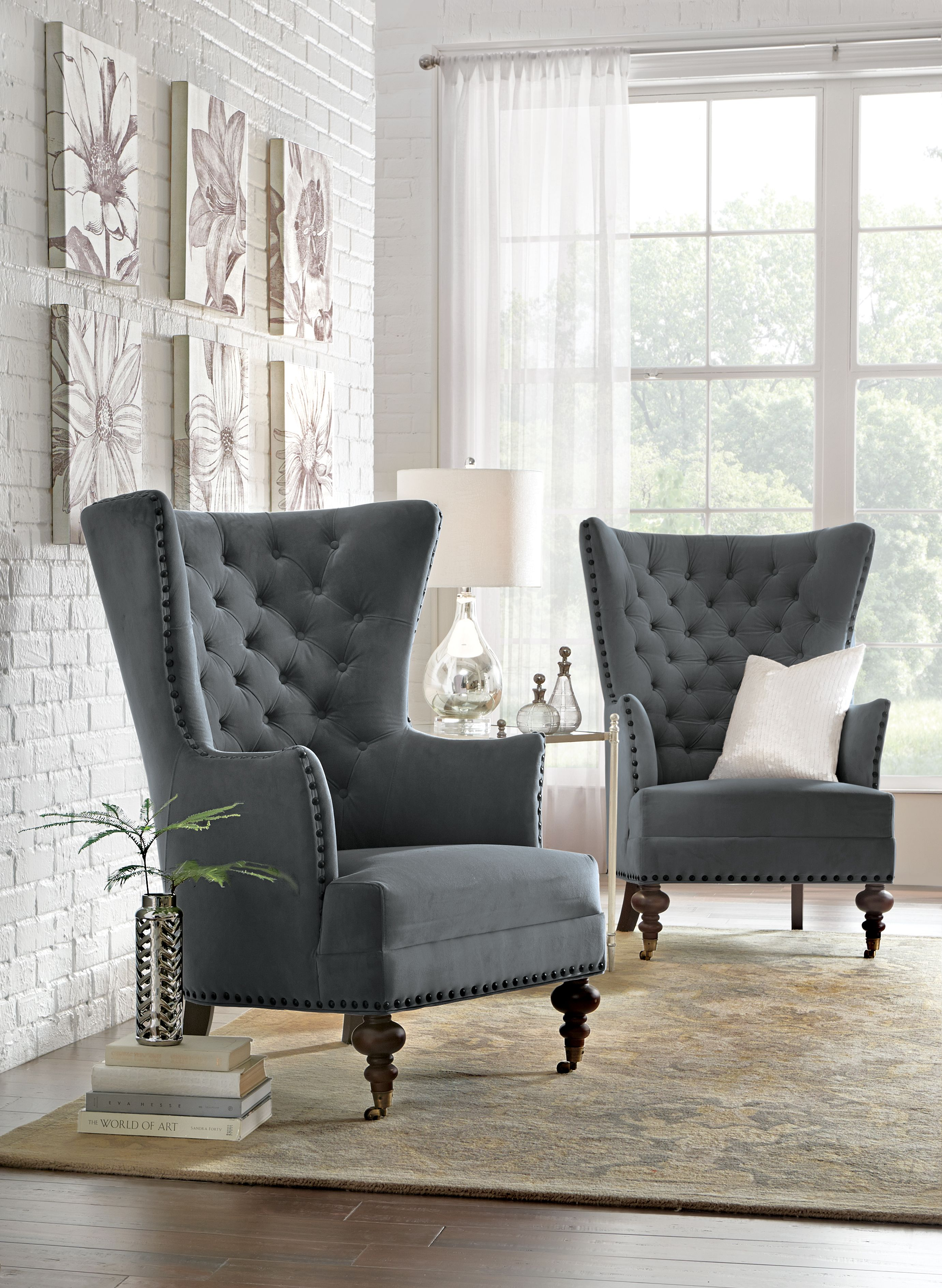 Uniquely shaped chairs are a perfect home accent. Traveller Location Winged  Armchair, Tufted