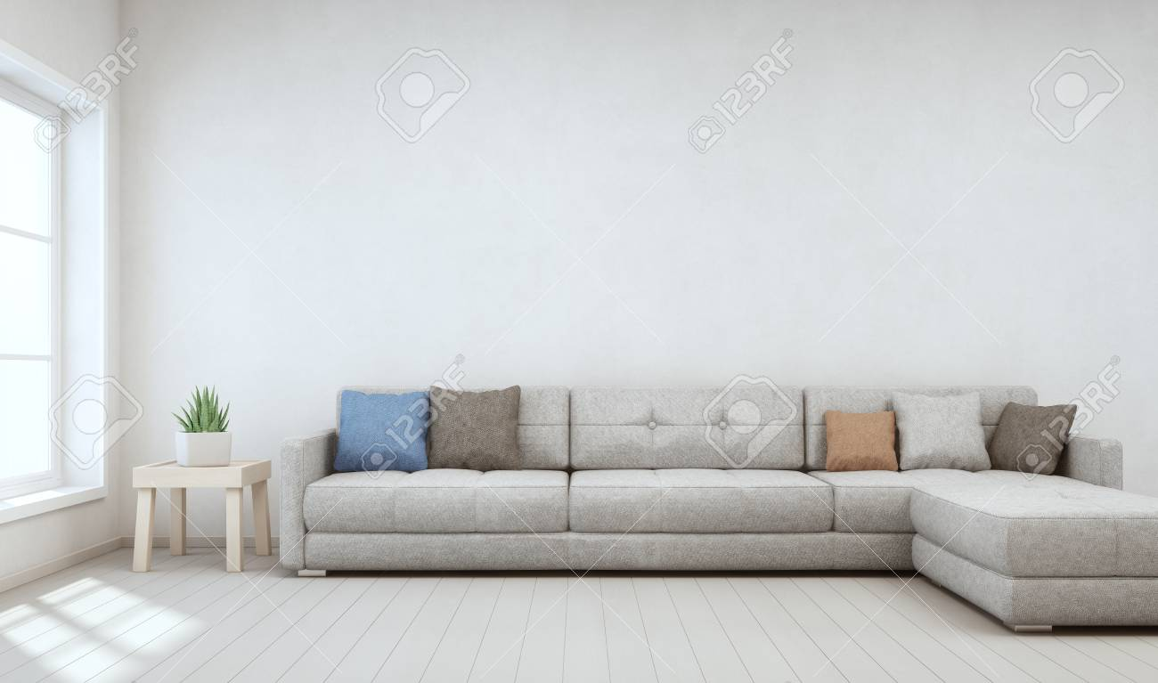 Indoor plant on wooden coffee table and big sofa with empty white concrete  wall background, Relaxing area near window in bright living room of modern