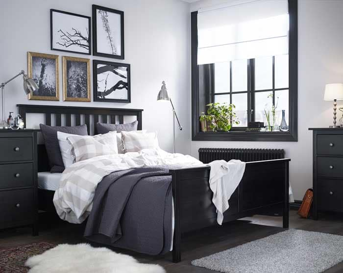 A bedroom featuring HEMNES solid wood bed, nightstand and wardrobe in black -brown