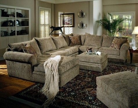 big super comfy sectional couch where both ottomans would fit in the middle  to make it like a giant bed. (inside 3rd floor)