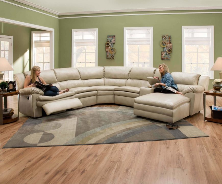 Soft wheat toned leather wraps this thick cushioned sectional, a lengthy  piece incorporating both a .