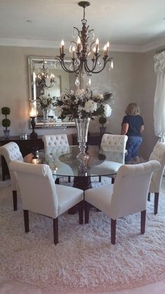 Remove the chandelier and center piece and this is perfect Glass Round Dining  Table, Dinning