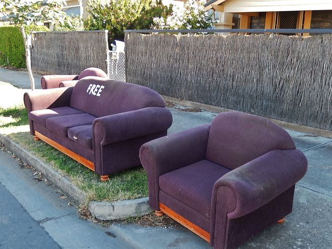 purple couches marked free at the curb