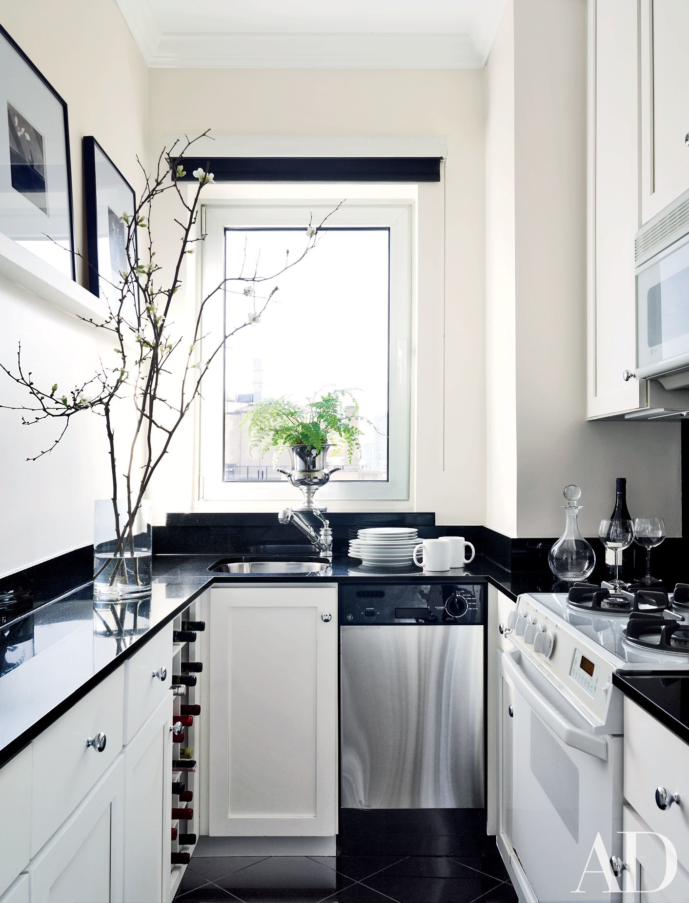 pBuiltin storage and appliances keep the countertops clear in this  Manhattan galley kitchen.p
