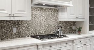 Kitchen with a honeycomb mosaic tile backsplash in a variety of shades.