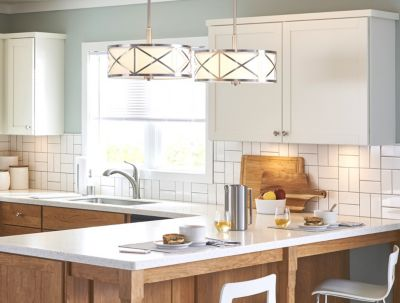 Kitchen with a backsplash featuring patterned white subway tile.
