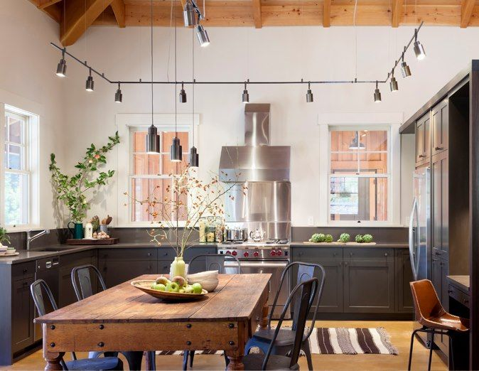 Industrial kitchen design with perimeter track lighting and rustic