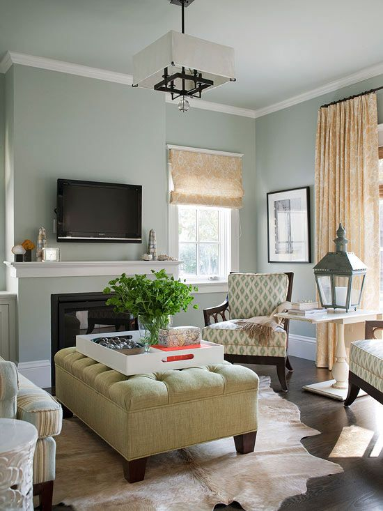 Comfy, Yet Chic:: The small living room at the front of the house functions  as a grown-up space for entertaining. The colors here mimic those used in  the