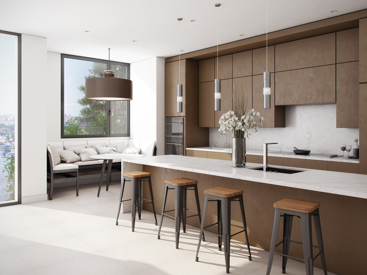 Spacious single wall with island modern kitchen done in medium brown and  white. The non
