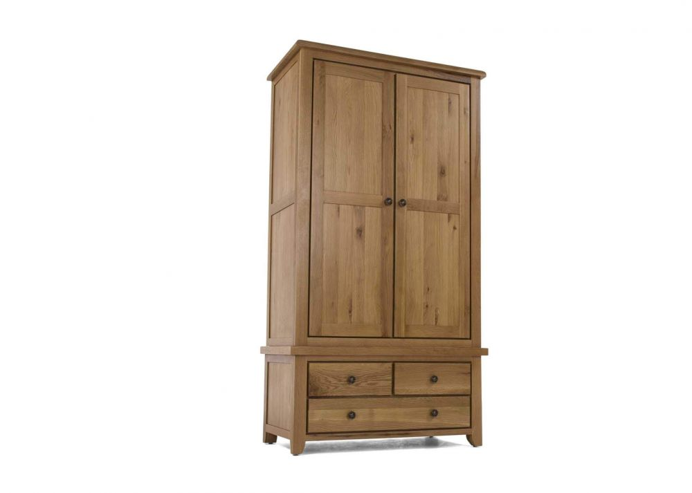 View from front side angle of the 2 door 3 drawer natural oak Cashel  wardrobe