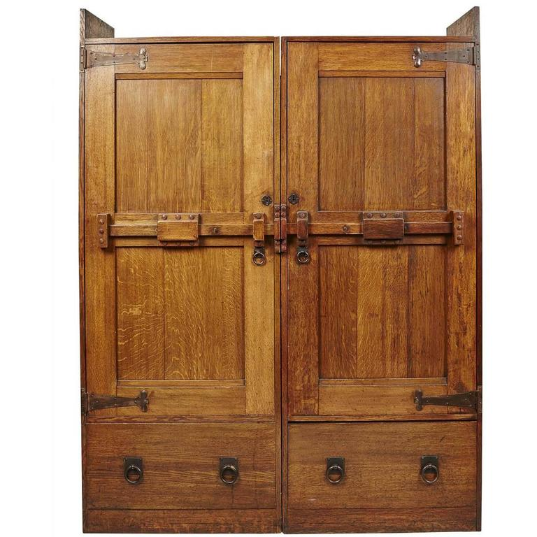 A Large Arts and Crafts Oak Wardrobe With Stylised Iron Hinges For Sale at  1stdibs