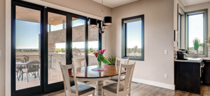 dining room with a milgard patio door leading outside