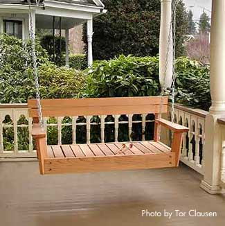 Wooden porch swing on beautiful porch