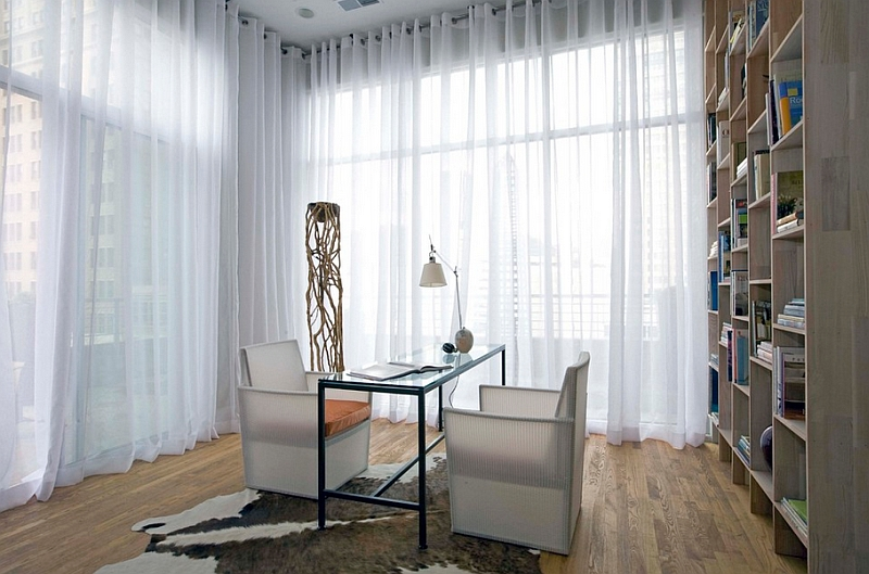 View in gallery Sheers hung from wall to wall give this home office a soft  effect