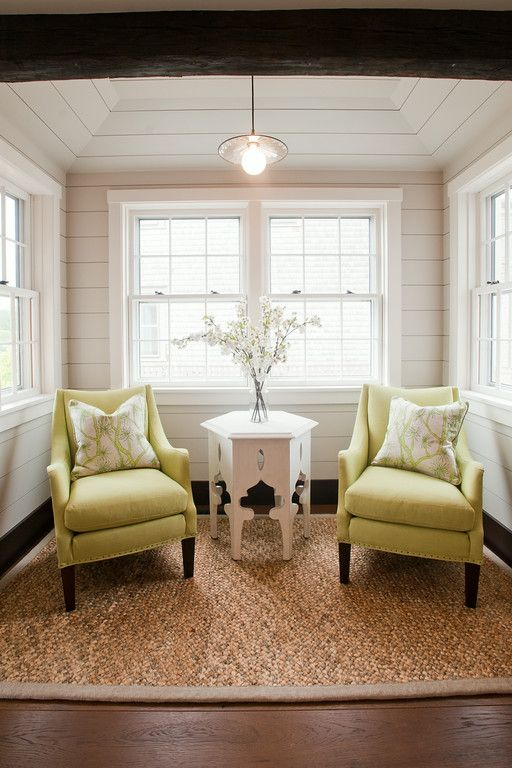 Small sitting area off the kitchen. We used lime green upholstered armchairs  to make this sweet area off of the kitchen into a cozy nook for 2.