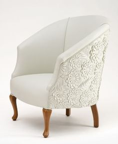 Small white armchair with beautiful fabric detailing on the back.  Upholstered Chairs, Sofa Chair