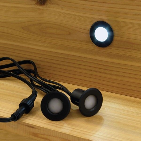 Deck step lights prevent trips and falls and a recessed LED step
