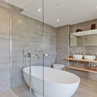 Bathroom - mid-sized contemporary master bathroom idea in Other with a  vessel sink,