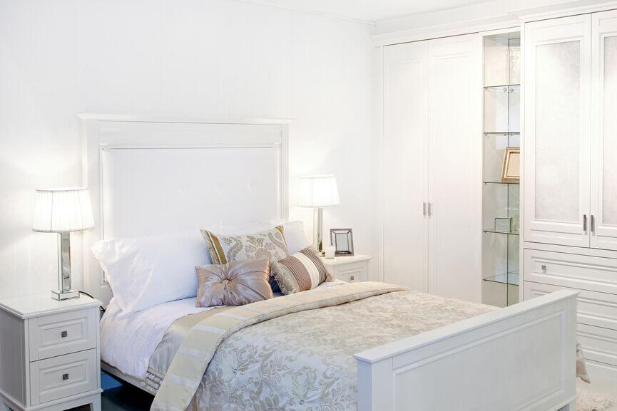 This glamorous room uses subtle, muted accents to offset the use of some  much white