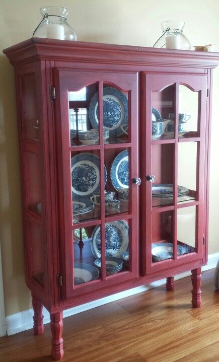 Repurposed top of hutch into Red distressed cabinet. Added legs and new  pulls. See more at Traveller Location in GA