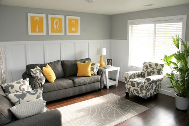 11 charcoal grey sofa and chair, yellow pillows and art pieces - DigsDigs